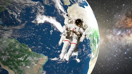 astronauta : astronaut in open space in front of earth. Vídeos