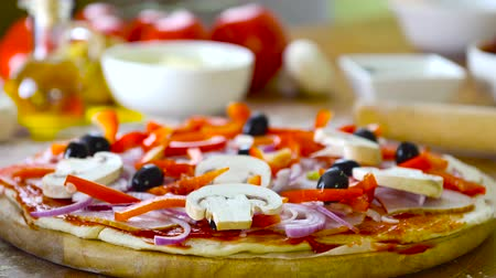 prepare food : prepearing tasty homemade pizza with fresh vegetables