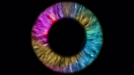 eye ball : The colored eye is an extreme close-up of the iris and pupil, widening and tapering.