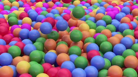candy : 4k 3D animation of a pile of abstract colorful spheres and balls, rolling and falling.Slow motion.