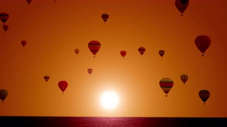 Balloons on a background of sunset on a beautiful sea. Balloon Festival. Super Slow Motion. Stockvideo