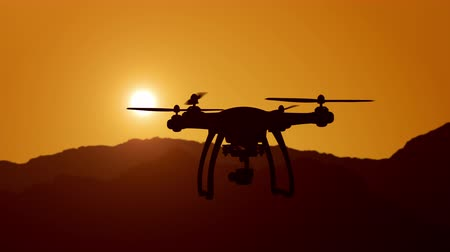 Aerial view of drone flying over mountains into the clouds during magical sunset.Super slow motion. Filmati Stock