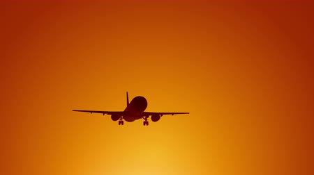 A large passenger plane takes off against the background of a sunset. Orange backgrand..Super slow motion. Stockvideo