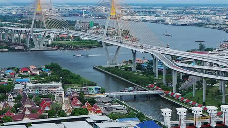 the suspension bridge : Traffic at the bridge over the Chao Phraya River in Bangkok Thailand