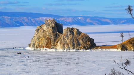 View of Mount Shamanka on Cape Burkhan at Olkhon Island in Frozen Lake Baikal Russia Stok Video