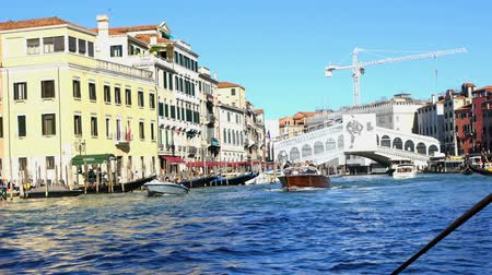 Venice, Italy - September 20, 2015 : View of the famous bridge with speed boats running in the canal in Venice, Italy