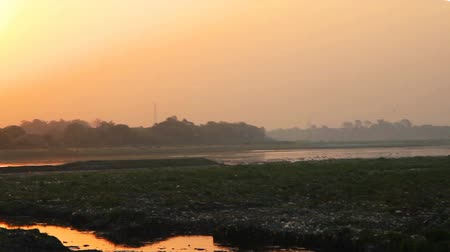 View of Taj Mahal and Yamuna River in the morning at sunrise, Agra, India