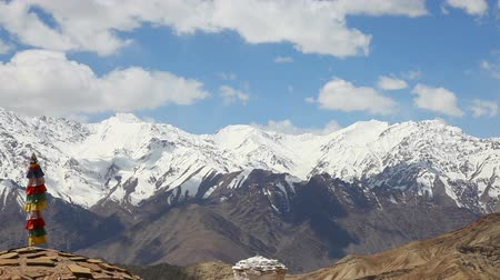 View of stupa in the valley of Lah with the snow mountain in the background, Ladakh, India