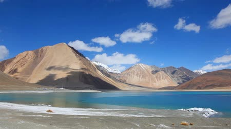 View of Pangong Lake with snow and frozen water at the shore in Ladakh, India Stok Video
