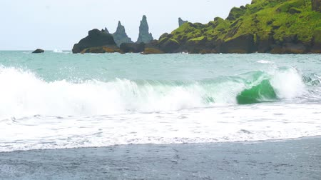 Waves in Atlantic Ocean at Reynisdrangar rock formation near Vik in Iceland 4K UHD