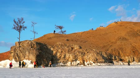 View of tourists at Cape Burkhan on Olkhon Island in the evening, Lake Baikal, Russia Stok Video