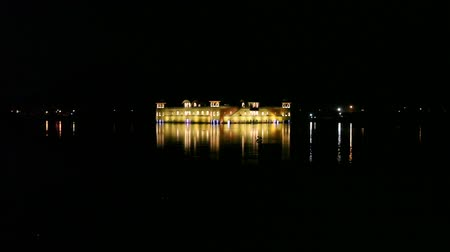 View of Jai Mahal, the historic water palace in Jaipur, Rajasthan, India in the night