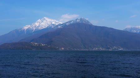 tampado : View of the Lake Lugano and the snow mountain in Lugano Switzerland Vídeos