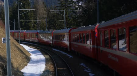 View of the old alpine mountain railway Bernina train running on the mountain Stok Video