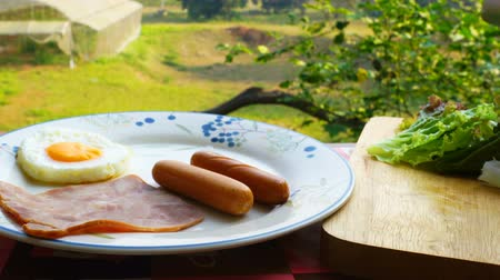 kiełbasa : Simple breakfast, Housewife prepare food in a white dish for breakfast