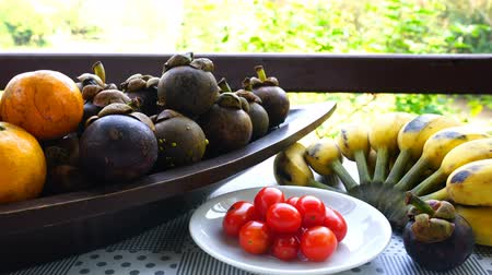 Different kind of natural sweet fruits on a table Stok Video