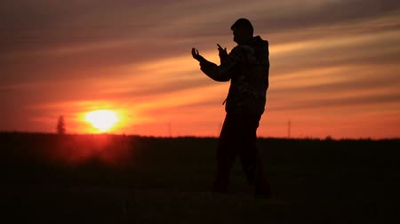 biodro : guy dances modern dance at sunset