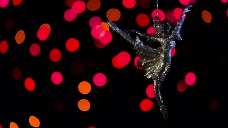 bugiganga : Keychain ballerina swinging on a chain on the background of beautiful bokeh closeup video. Stock Footage