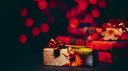 intrigue : Beautiful colorful christmas gifts on the background bokeh.
