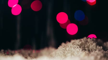 queda de neve : Imitation of falling snow on a colorful bokeh background.