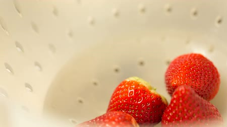 In a bowl of strawberries put another. Video full hd. 影像素材