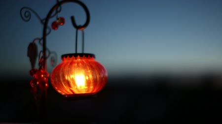 Red Lantern with a candle swaying in the wind at night 影像素材