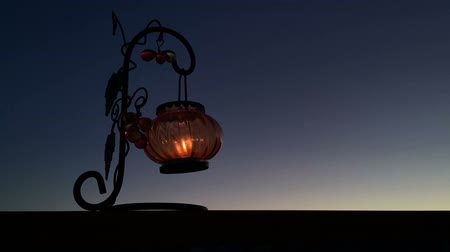 Timelapse Lantern with a candle swaying in the wind at night