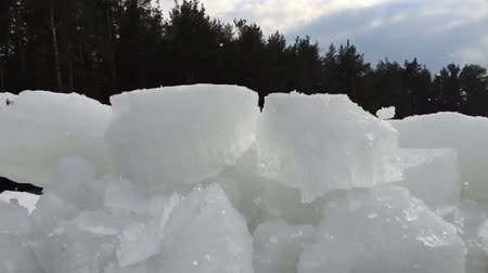 Big chunk of ice broken into small pieces. Slow motion video. 影像素材