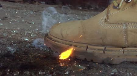 Burning yellow boots close-up in slow-motion