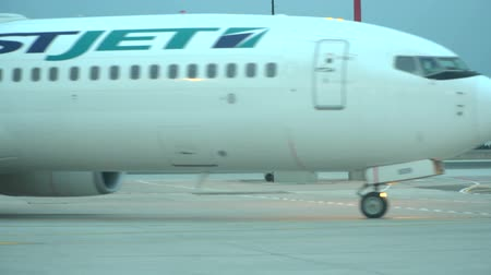turbine : A West Jet Boeing 737 Departs the Deicing Pad on its way to the runway Stock Footage