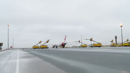 turbine : Deicing Trucks approach and Air Canada Rouge Boeing 767 as it waits to be deiced