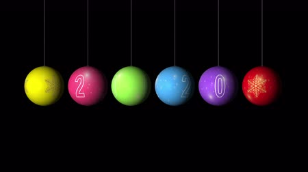 Set Looping realistic animation of the Christmas and New Year multicolored Balls with a golden snowflake and text 2020. Rotating decoration on white background. Merry Christmas and a Happy New Year! Animation with Alpha (transparent background) for easy u Stok Video