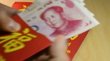 bao : The red envelope or hong bao is used for giving money during Chinese New Year in 2018 or Dogs year Stock Footage