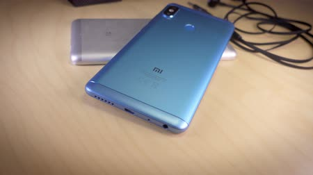 mi : Barcelona, Spain. July 10: Xiaomi smartphones, headphones and yi 4k action camera Stock Footage