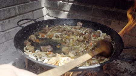 szépia : Cooking spanish paella, step 1 Stock mozgókép