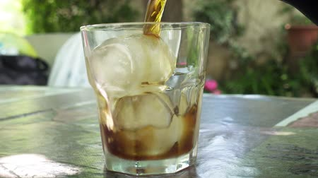 vermouth : Pouring a glass of cold verouth with ice