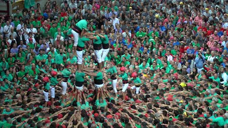 каталонский : Tarragona, Spain. October 2018: Castells Performance in the XXVII Tarragona Human Tower Competition. A castell is a human tower built traditionally in festivals within Catalonia. Стоковые видеозаписи