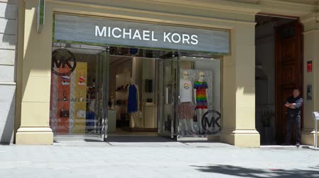 michael : Barcelona, Spain. June 2019: People walking in front of Michael Kors store