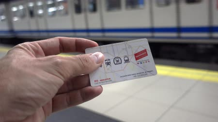 ticket machine : Madrid, Spain. July 2019: Hand with Public transport card of Madrid.