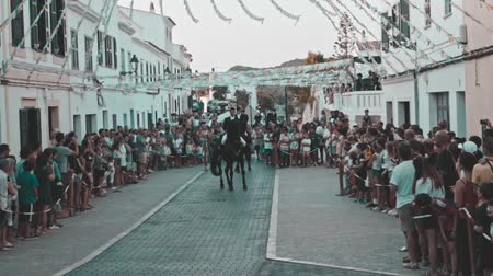 baleár : Slow motion view of riders rear up on his horse during a horse celebration in the Spanish island of Minorca Stock mozgókép