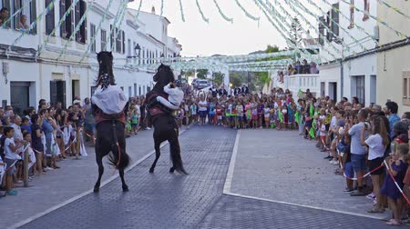 baleár : Riders rear up on his horse during a horse celebrations in the Spanish island of Minorca Stock mozgókép