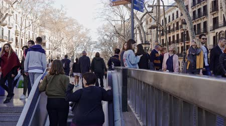 katalán : Barcelona, Spain. March 19: People walking and leaving the subway at the famous La Rambla in Barcelona, Spain.
