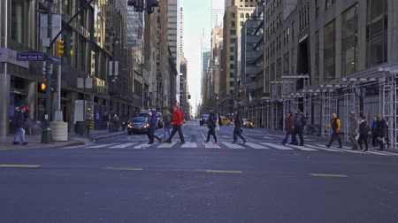 ave : people crossing the crosswalk on Lexington Ave and 42nd Street in New York City, United States