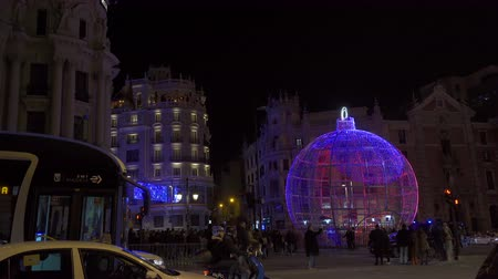 díszített : Madrid, Spain, December 2019. Giant Christmas LED Ball show in Gran Via , Madrid