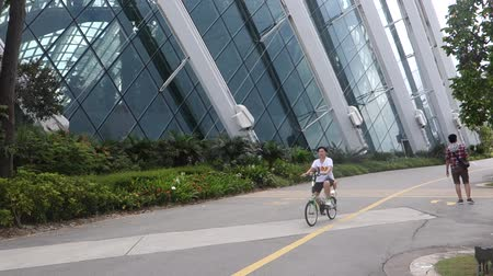 Unidentified cyclists cycle in Garden by the Bay in Singapore