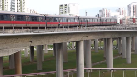 Singapore mass rapid train MRT travels on the track