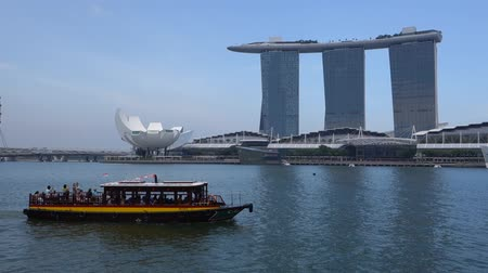 Ferry boat and Skyline in Downtown Core at Marina Bay Financial Center in Singapore.