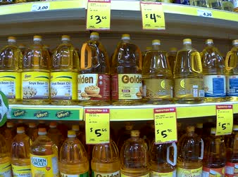 Various brands of cooking oils on the rack of supermarket in Singapore