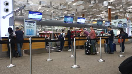 SINGAPORE- 10 DEC, 2017: Check in counters at Changi International Airport in Singapore. Changi Airport is one of the largest transportation hubs in Asia.
