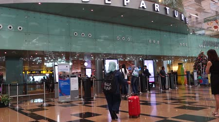 lobby : Passengers leave via departure hall in Terminal 3 in Changi Airport Singapore
